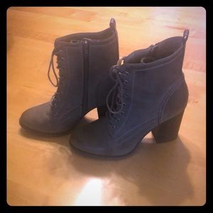 Lace up high heeled booties
